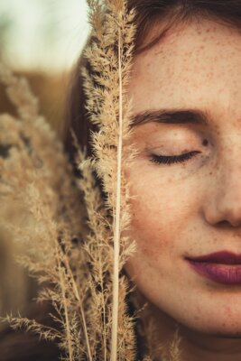 Woman closing her eyes with close up to her face